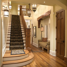 Traditional Staircase by Charlie & Co. Design, Ltd