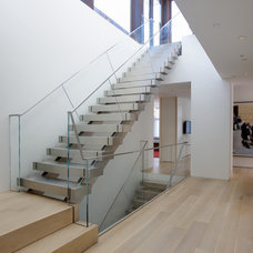 Contemporary Staircase by d'apostrophe design, inc.