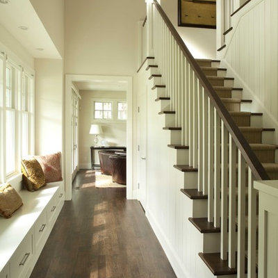Inspiration for a timeless wooden u-shaped wood railing staircase remodel in Minneapolis with painted risers