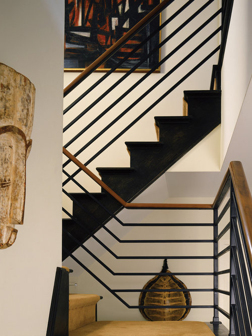 Inspiration for a contemporary metal railing staircase remodel in New York