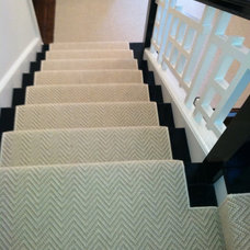 Contemporary Staircase by The Carpet Workroom and Reclamation Center, Inc.