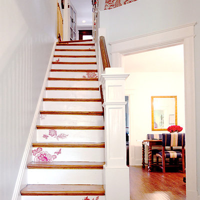 Inspiration for a shabby-chic style wooden straight staircase remodel in DC Metro with painted risers