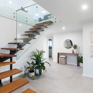 Example of a mid-sized trendy wooden l-shaped open staircase design in Sydney