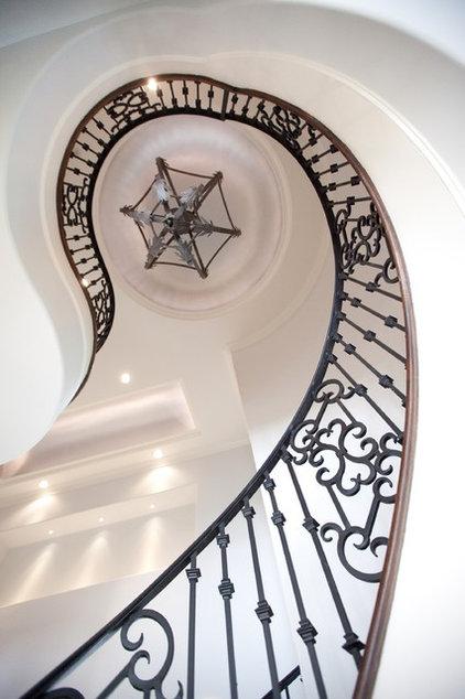 Mediterranean Staircase by Amitha Verma Interior Design, LLC