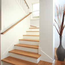 Traditional Staircase by Anchor Builders