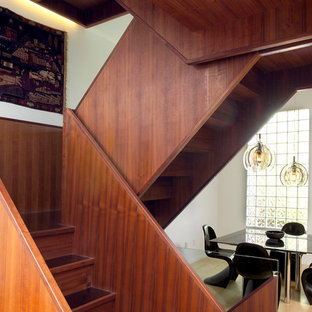 Trendy wooden staircase photo in Toronto with wooden risers