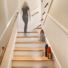 eclectic staircase by BCV ARCHITECTS