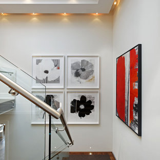 Example of a trendy wooden staircase design in Toronto