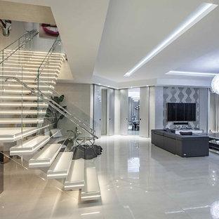 Diseño de escalera suspendida, contemporánea, grande, sin contrahuella