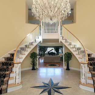 Staircase - large victorian painted u-shaped staircase idea in New York with wooden risers