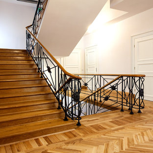Staircase - large modern painted spiral staircase idea in New York with wooden risers
