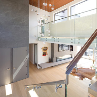 Staircase - contemporary metal railing staircase idea in Vancouver with glass risers