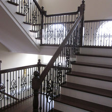 Traditional Staircase by Regency Builders Inc.