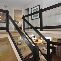 modern staircase by The Design Den Homes Inc.