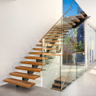Design ideas for a contemporary wood l-shaped staircase in Sydney.