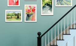 Staircase with Eclectic Gallery Wall Arrangement