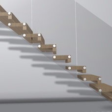 Modern Staircase by Cabinets by Design