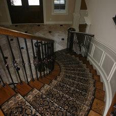 Traditional Staircase by Kisarau Architect, LTD.