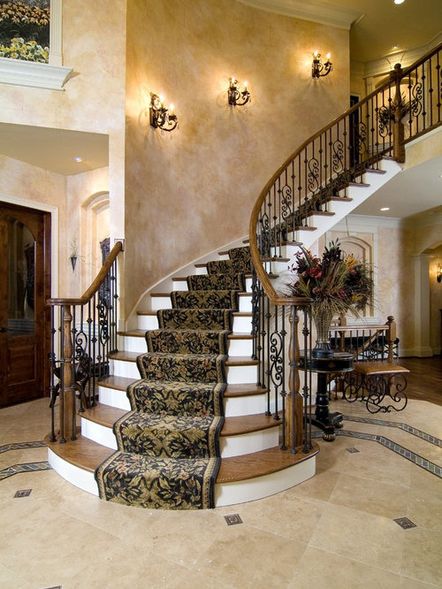 Attractive Example Of A Classic Wooden Curved Metal Railing Staircase Design In Chicago