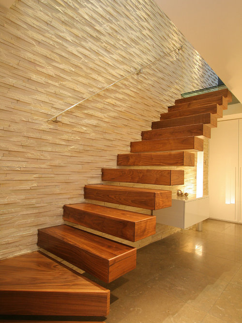 Inspiration for a contemporary wooden l-shaped open staircase remodel in  London