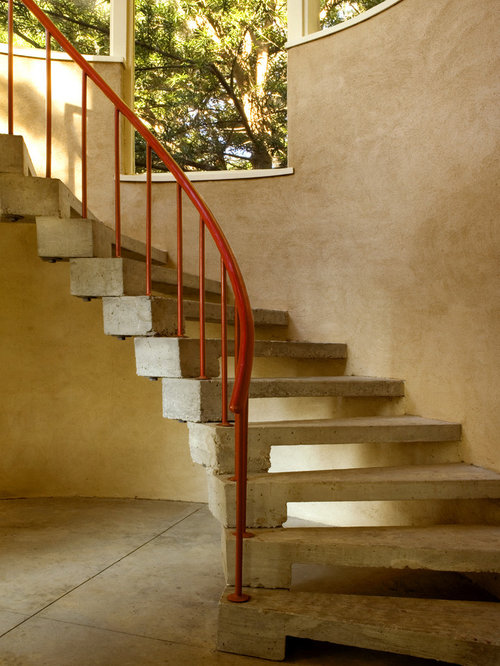 Inspiration For A Mid Sized Industrial Concrete Curved Open And Metal  Railing Staircase Remodel In