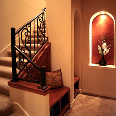 Mediterranean Staircase by Asomoza Homes - Design Build