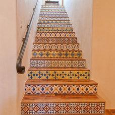 Mediterranean Staircase by Butter Lutz Interiors, LLC