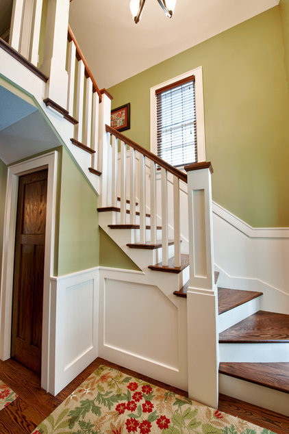 Traditional Staircase by First Class Construction Inc.