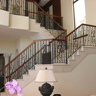 Large tuscan l-shaped staircase photo in Miami