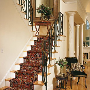 Inspiration for a mid-sized timeless wooden u-shaped staircase remodel in Orange County