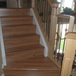 Example of a painted spiral staircase design in Edmonton with painted risers