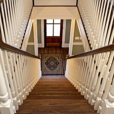 Farmhouse Staircase by Vintage Builders
