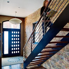 Contemporary Staircase stairs with brick wall