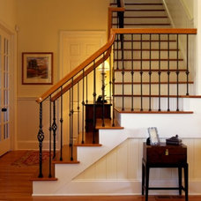 Traditional Staircase by Bill Huey + Associates