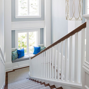 Example of a large transitional wooden u-shaped wood railing staircase design in Minneapolis
