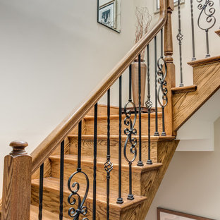 Mid-sized transitional wooden u-shaped mixed material railing staircase photo in New York with wooden risers