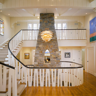 Example of a coastal curved staircase design in Boston
