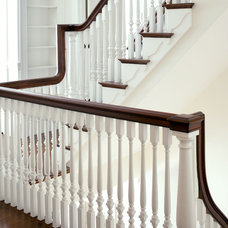 Traditional Staircase by The Remodeling Company