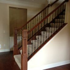 Traditional Staircase by Troyer Woodworks Inc.