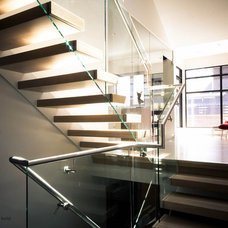 modern staircase by Element Design Build Inc.