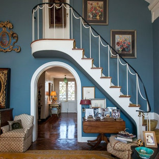 Example of a classic carpeted l-shaped metal railing staircase design in Nashville with carpeted risers