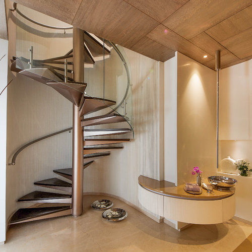 Example Of A Trendy Spiral Open And Metal Railing Staircase Design In Pune