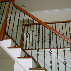 Traditional Staircase by Capozzoli Metalworks