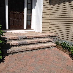 Example of a classic concrete straight staircase design in Bridgeport with concrete risers