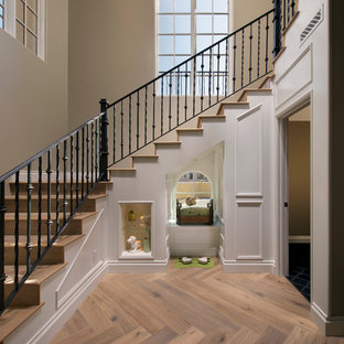 Example of a transitional wooden staircase design in Phoenix with wooden risers