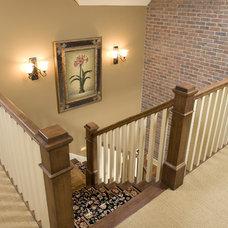 Farmhouse Staircase by Bob Michels Construction, Inc.