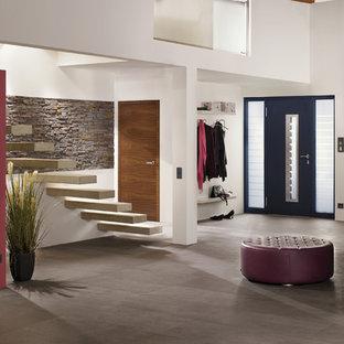 Inspiration pour un petit escalier flottant design avec des marches en béton.