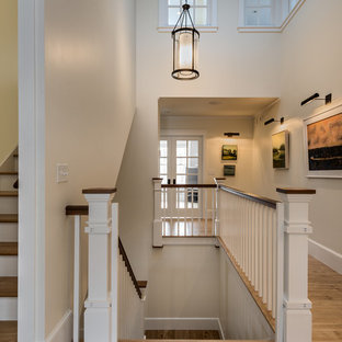 Inspiration for a large timeless wooden u-shaped staircase remodel in Portland Maine with wooden risers