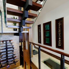contemporary staircase by Fritz Construction, Inc.
