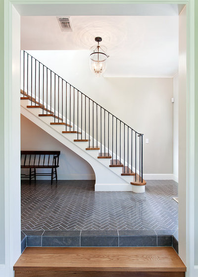 Traditional Staircase by Audino Construction, Inc.